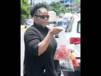 National javelin thrower, Olivia McKoy who has represented Jamaica at the 2000 Sydney Olympic Games and returned eight years later to participate at the Beijing showpiece is now selling bag juice in an attempt to survive. (PHOTOS: Jamaica Observer)