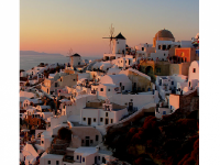 Photo Credit: Wikimedia Commons - Oia Sunset in Santorini Greece.