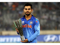 Photo Credit: Wikipedia - Virat Kohli posing after winning the Man of the tournament trophy in Dhaka.