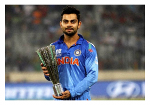 Photo Credit: Wikipedia - Virat Kohli posing after winning the Man of the tournament trophy in Dhaka.