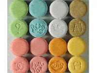 Photo Credit: Wikipedia - Tablets containing MDMA.
