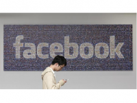Photo Credit: china Daily - In this June 11, 2014 photo, a man walks past a Facebook sign in an office on the Facebook campus in Menlo Park, Calif. (AP Photo/Jeff Chiu)