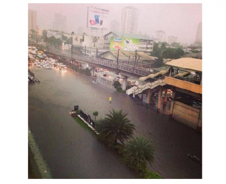 Photo Credit: Wikipedia - Flooded EDSA due to the enhancement of southwest monsoon by Tropical Storm Fung-wong (Mario) on September 19, 2014.
