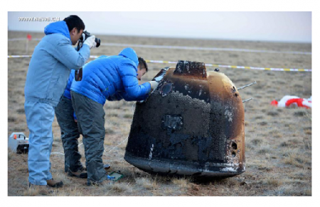 Photo Credit: xinhuanet.com - Researchers retrieve the return capsule of China's unmanned lunar orbiter in the central region of North China's Inner Mongolia autonomous region, Nov 1, 2014.