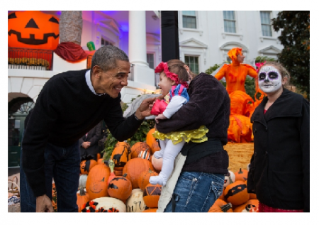 Photo credit: the White House - President Barack Obama hands treats out to local children and children of military families for trick-or-treat at the South Portico of the White House on Halloween.