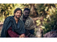 "Photo Credit: Photo from the episode ""The Spirit Arrives"" (Adam Levy as Peter and Babou Alieu Ceesay as John)"