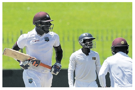 Photo Credit: Jamaica Observer - West Indies batsman Carlos Brathwaite (left) runs between the wickets on day two of the three-day warm-up match against Sri Lanka President's XI at the Singhalese Sports Club in Sri Lanka.
