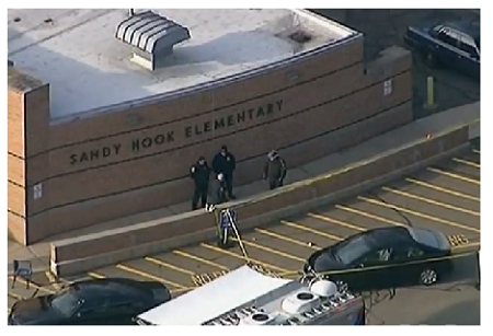 Photo Credit: VOA - Police arrive at Sandy Hook Elementary, after the shooting on December 14, 2012.