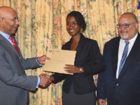 Governor-General, His Excellency the Most Hon. Sir Patrick Allen (left), congratulates Shakeba Foster on being named Jamaica's 2017 Rhodes Scholar during a brief ceremony at King's House on November 17. At right is Jamaica's Secretary to the Rhodes Trust and Secretary of the Jamaican Selection Committee, Peter Goldson Photo credit: Rudranath Fraser