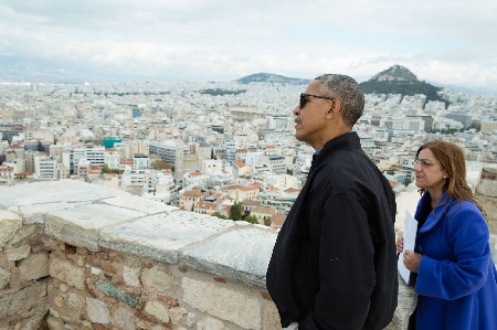 President Barack Obama looks at the view from Belvedere Tower during a tour of the Acropolis in Athens, Greece, Nov. 16, 2016. Dr. Eleni Banou, Director, Ephorate of Antiquities for Athens, Ministry of Culture, leads the tour. (Official White House Photo by Pete Souza)