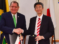Minister of Finance and the Public Service, Hon. Audley Shaw (left); and Senior Vice President, Japan International Cooperation Agency (JICA), Shigeru Maeda, exchanging copies of the co-financing loan contract for the Energy Management and Efficiency Program (EMEP), which they signed on Thursday, (November 23) in the Executive Conference Room at the Ministry of Finance and the Public Service, Kingston. (Photo credit: Adrian Walker)