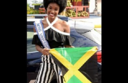 Davina Bennett holds the Jamaican flag on her return from Las Vegas where she placed third in the Miss Universe pageant - Photo credit: Jamaica Gleaner