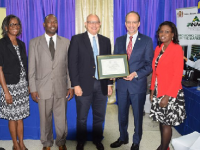 Photo: Contributed Executive Director of the Caribbean Public Agency-Drug Testing Laboratory (CARPHA-DTL), Dr C. James Hospedales (second right) displays the certificate of accreditation presented by Chairman of the Accreditation Council of the Jamaica National Agency for Accreditation (JANAAC), Simon Roberts (centre), during a ceremony held recently at CARPHA'S Hope Gardens offices in St. Andrew. Others (from left) are former Head of Department at CARPHA, Dr. Lucette Cargill; Technical Officer for Accreditation, CARICOM Regional Organisation for Standards and Quality (CROSQ), Stephen Farquharson; and Acting Head of CARPHA, Sonia Thomas Gordon.
